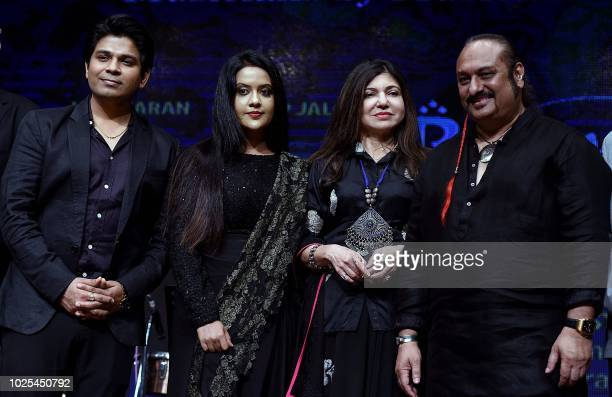 Indian Bollywood playback singers Ankit Tiwari Amruta Fadnavis Alka Yagnik and Lesle Lewis attend the charitable music concert 'Rehmatein' to raise...