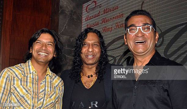 Indian Bollywood playback singers Shaan Vinod Rathod and Abhijit Chaterjee pose during the music launch ceremony for the forthcoming Hindi film 'Say...