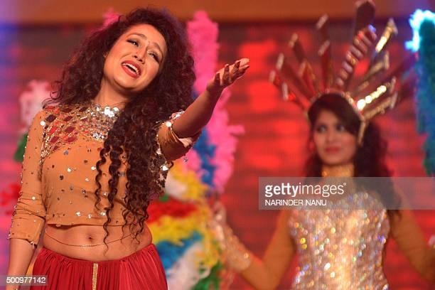 Indian bollywood playbacksinger Neha Kakkar performs during the 'Radio Mirchi Awards Punjabi' function in Amritsar on December 112015 / AFP /...