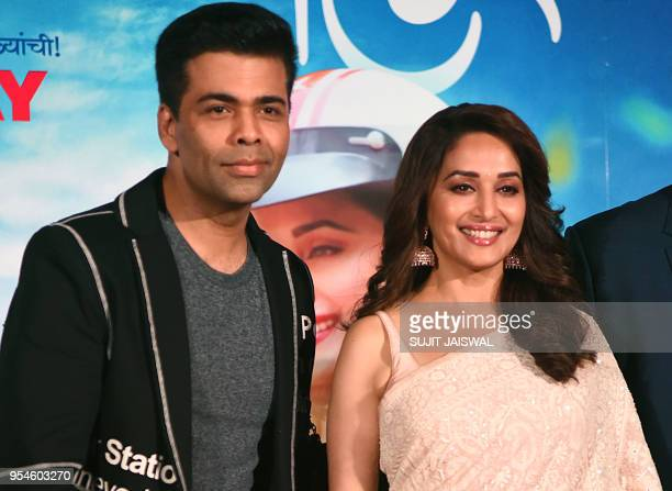 Indian Bollywood producer and director Karan Johar and actress Madhuri Dixit pose for photograph during a promotional event for the forthcoming...