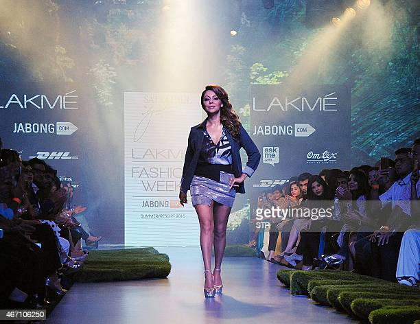 Indian Bollywood producer and wife of actor Shah Rukh Khan Gauri Khan showcases a creation by designer Satya Paul on the third day of the Lakme...