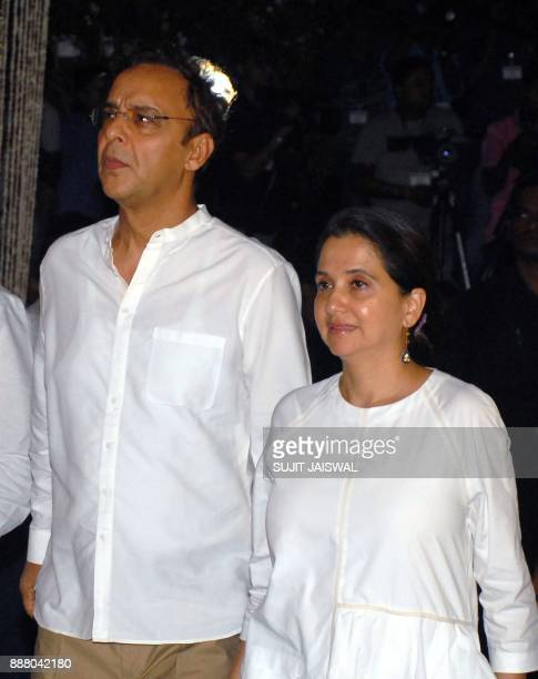 Indian Bollywood producerdirector Vidhu Vinod Chopra with his wife Anupama Chopra attend a preyer meet for the late Bollywood actor Shashi Kapoor at...