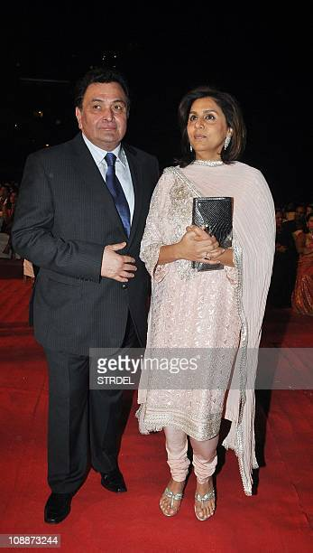 Indian Bollywood Rishi Kapoor with wife Neetu Singh pose on as they attend the Stardust Awards 2011 ceremony in Mumbai on February 6 2011 AFP...