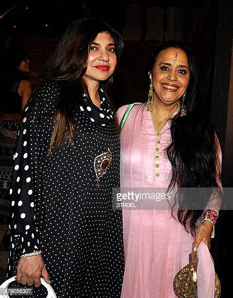 Indian Bollywood Singer Illa Arun and actress Alka Yagnik attend the Colors IAA Awards and after party in Mumbai on March 1 2014 AFP PHOTO/STR