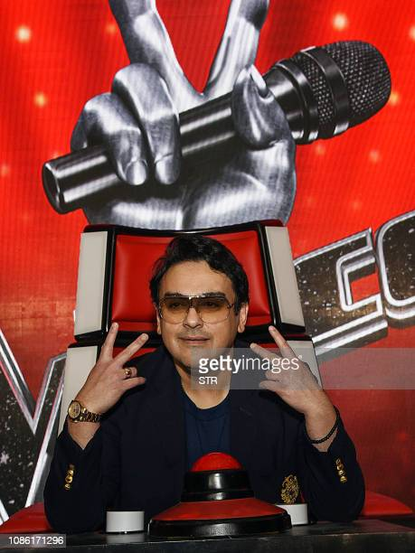 Indian Bollywood singer musician and music composer Adnan Sami gestures on stage at the TV singing reality talent show 'The Voice' in Mumbai on...