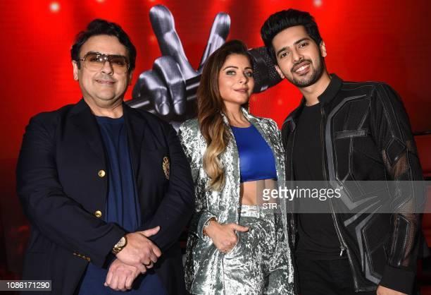 Indian Bollywood singer musician and music composer Adnan Sami playback singers Kanika Kapoor and Armaan Malik pose for photographs for the media at...