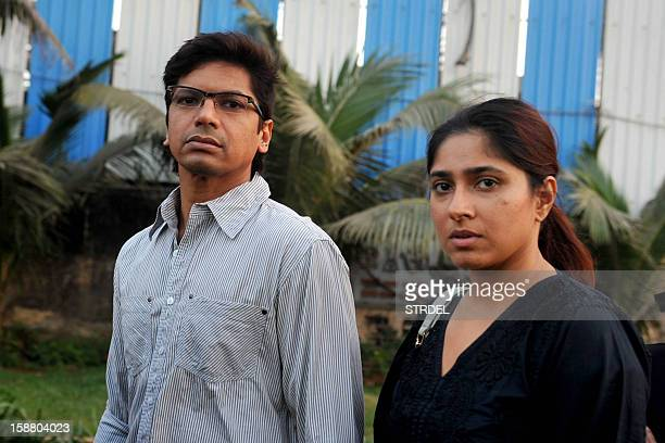 Indian Bollywood singer Shaan and his wife Radhika Mukherjee take part in a candlelight vigil in Mumbai on December 29 after the death of a gangrape...