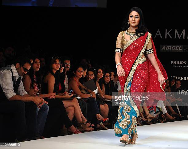 Indian Bollywood singer Sunidhi Chauhan displays a creation by Indian designer Shyamal Bhumika on the fourth day of Lakme Fashion Week Winter/Festive...