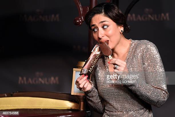 Indian Bollywood star Kareena Kapoor struggles to keep an ice cream bar from crumbling after she bit into it during the launch of an ice cream bar at...