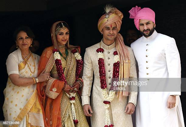 Indian Bollywood veteran actress Sharmila Tagore and Saif Ali Khan pose during the wedding of Soha Ali Khan and Kunal Khemu in Mumbai on January 25...