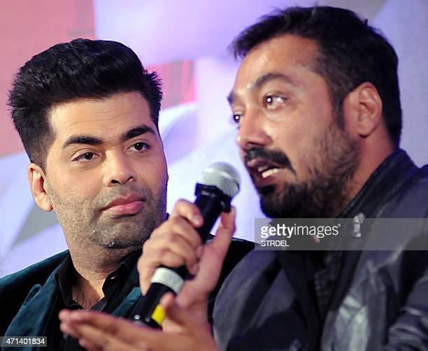 Indian Bollywood writer director and producer Anurag Kashyap speaks as Bollywood actor Karan Johar looks on during a promotional event for his...