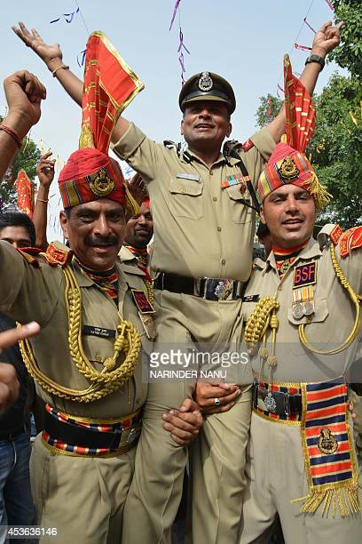 Indian Border Security Force Commandant Satish Kumar and BSF soldiers dance during a ceremony to celebrate Indias 68th Independence Day at the India...