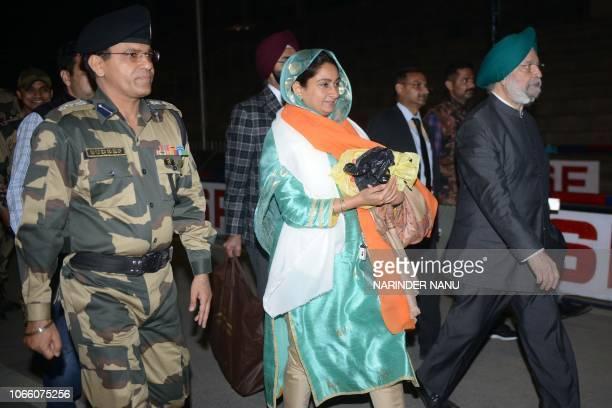 Indian Border Security Force Commandant Sudeep escort Union Ministers Harsimrat Kaur Badal and Hardeep Singh Puri arrive after attending the...