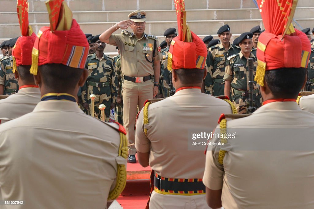 Indian Border Security Force Commandant Sudeep salutes during a ceremony to celebrate India`s Independence Day at the IndiaPakistan Wagah border post.