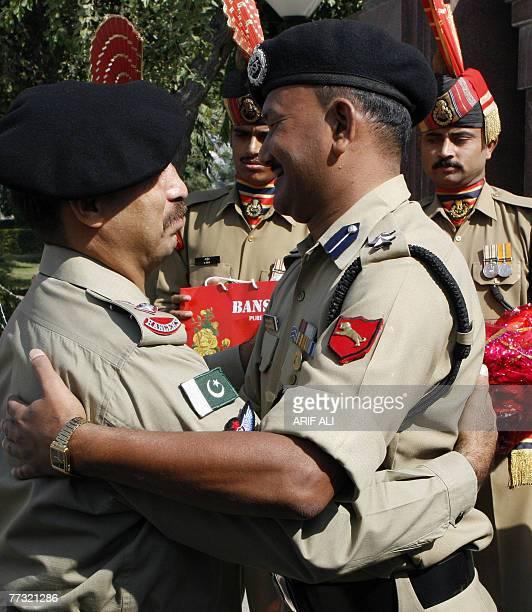 Indian Border Security Force Commander Bhagat Singh Tolia greets Pakistani Rangers Wing Commander Lt Colonel Tariq Janjua on the occasion of Eid...