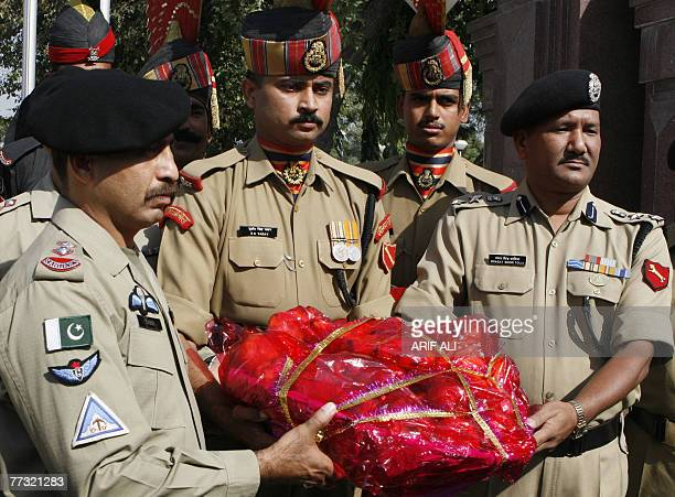 Indian Border Security Force Commander Bhagat Singh Tolia presents sweets to Pakistani Rangers Wing Commander Lt Colonel Tariq Janjua on the occasion...