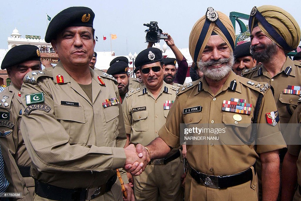 Indian Border Security Force Deputy Inspector General G S Virk shakes hands with Pakistan Rangers Brigadier Qaiser Khan Tareen at the IndiaPakistan...