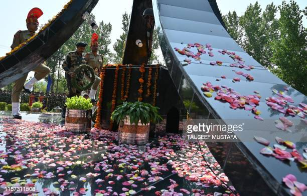 Indian Border Security Force officer lays wreath as he pays homage to slain soldiers who lost their lives in Kargil War at a war memorial inside a...
