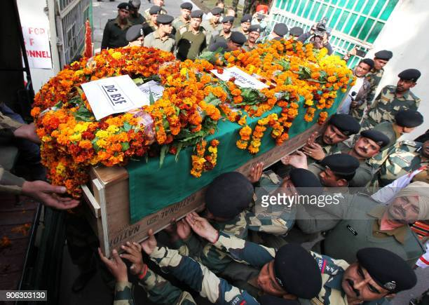 Indian Border Security Force officers carry the coffin of slain Head Constable A Suresh during a wreathlaying ceremony at the BSF headquarters in...