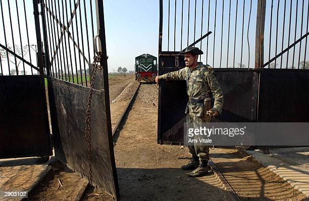 Indian Border Security Force officers open the only rail border crossing as a train coming from Pakistan enters Indian territory at the Wagah border...
