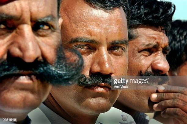 Indian Border Security Force officers prepare to give a demonstration during the Desert Festival of Jaisalmer on February 5 2004 in Rajasthan India...
