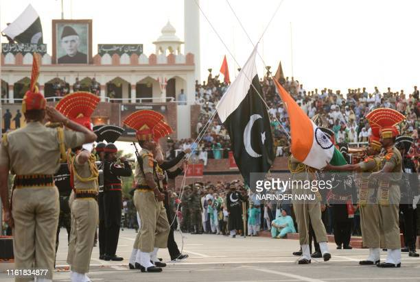 Indian Border Security Force personnel and Pakistani Rangers take part in the Beating Retreat ceremony at the India Pakistan Wagah border post some...