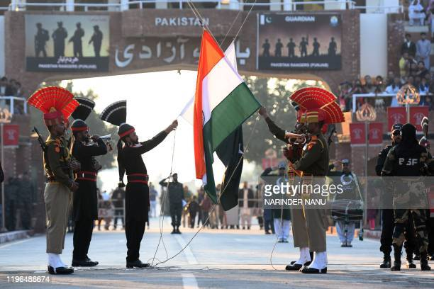 Indian Border Security Force personnel and Pakistani Rangers take part in the Beating Retreat ceremony on the occasion of India's Republic Day at the...