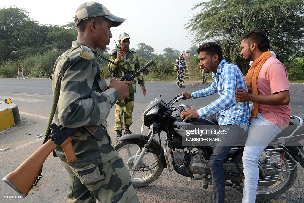 Indian Border Security Force personnel do a security check at the IndiaPakistan Wagah Border about 35 km from Amritsar on September 29 after the...