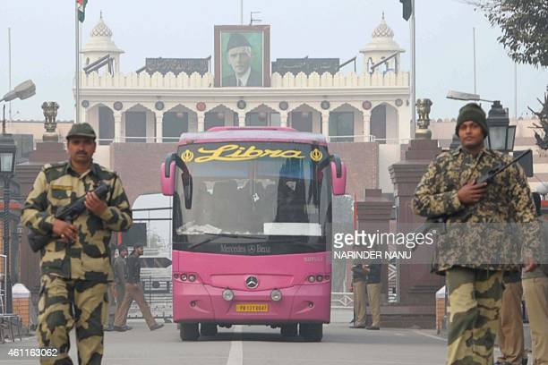 Indian Border Security Force personnel escort the DelhiLahore bus carrying some 14 Pakistani passengers as it crosses the IndiaPakistan border in...