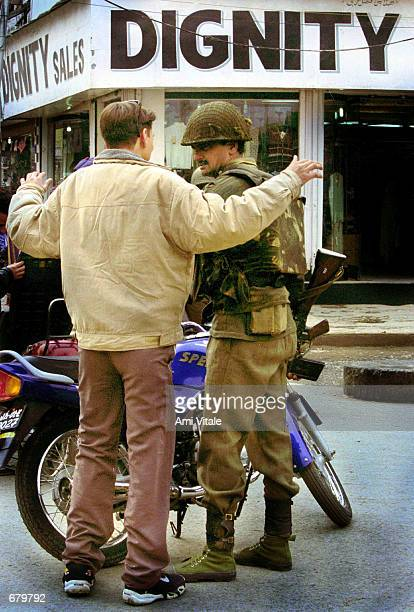 Indian Border Security Force personnel frisk civilians at Srinigar's main commercial hub in the state of Kashmir November 5 2001 in India Security...