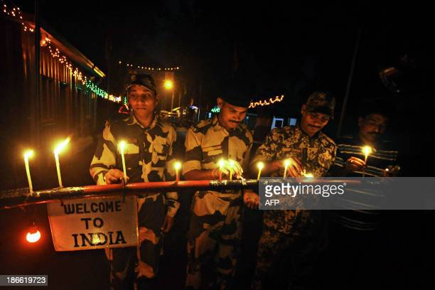 Indian Border Security Force personnel light candles at the IndiaBangladesh border crossing at Akhaura in Agartala the capital of northeastern Indian...