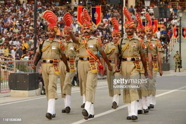 Indian Border Security Force personnel march during the Beating Retreat ceremony at the India Pakistan Wagah border post some 35 kms from Amritsar on...