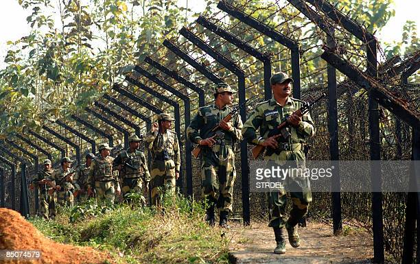 Indian Border Security Force personnel patrol a stretch of the IndianBangladesh border on the outskirts of Agartala on February 25 after a fierce gun...