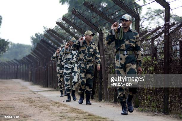 Indian Border Security Force personnel patrol along the IndiaBangladesh border on the eve of Prime Minister Narendra Modi's political rally ahead of...