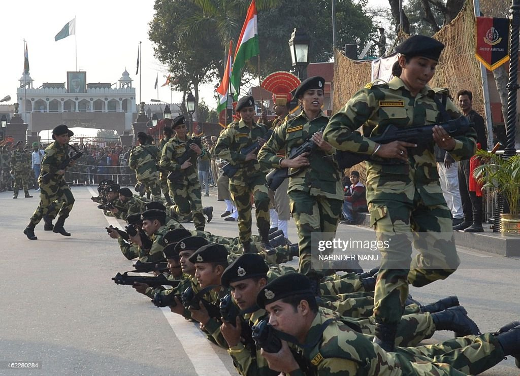 Indian Border Security Force personnel perform during an event to mark the country`s 66th Republic Day at the IndiaPakistan Wagah Border Post on...