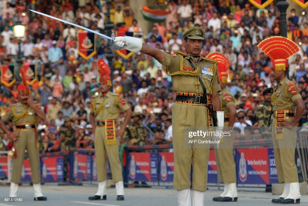Indian Border Security Force personnel perform during the daily beating of the retreat ceremony at the IndiaPakistan Wagah Border Post some 35kms...