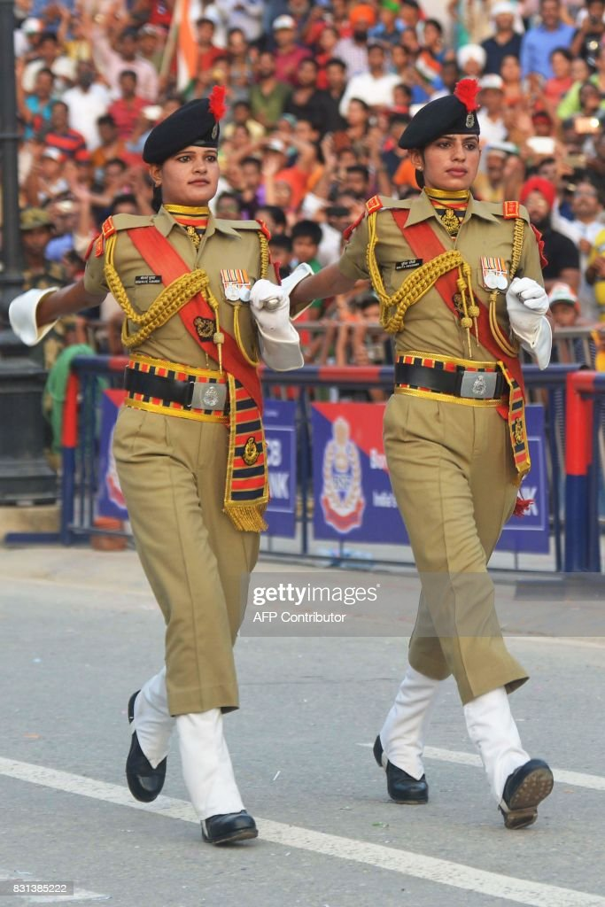 Indian Border Security Force personnel perform during the daily beating of the retreat ceremony at the IndiaPakistan Wagah Border Post about 35 Km...