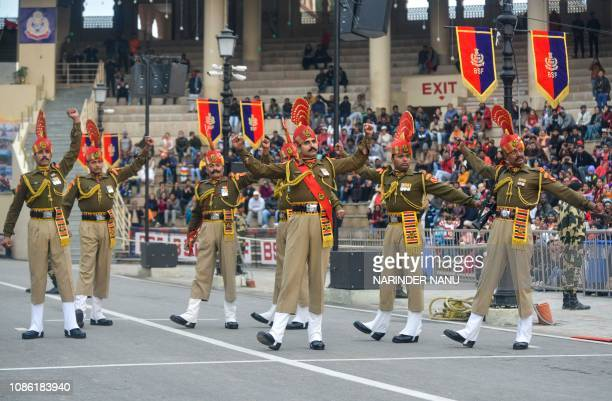 Indian Border Security Force personnel perform while they take part in the Beating Retreat ceremony at the IndiaPakistan WagahAttari border post...