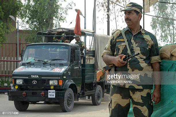 Indian Border Security Force personnel stand guard at the IndiaPakistan Wagah border some 35kms from Amritsar on October 1 2016 after the Punjab...