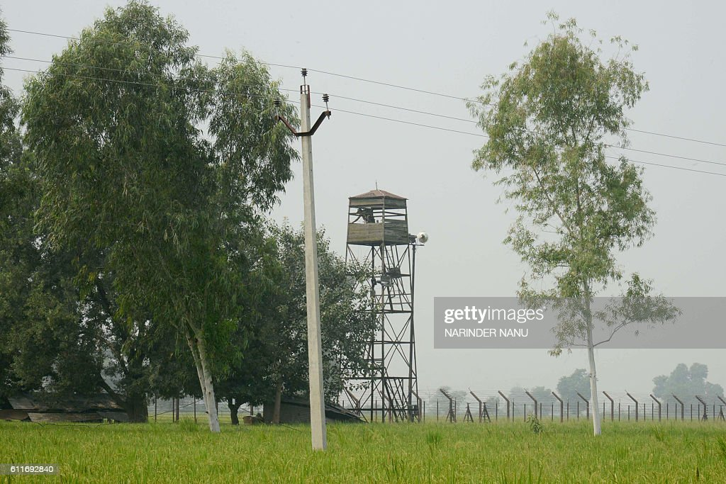 Indian Border Security Force personnel stand inside a watchtower at the IndiaPakistan border village Chak Allah Bakash about 45 kms from Amritsar on..