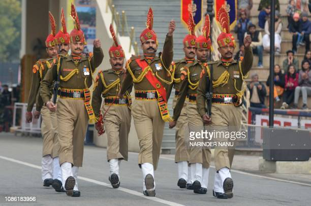 Indian Border Security Force personnel take part in the Beating Retreat ceremony at the IndiaPakistan WagahAttari border post about 35 kms from...