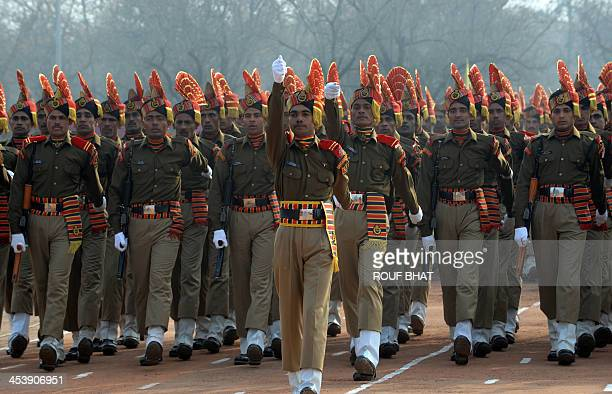 Indian Border Security Force recruits march during their passing out parade in Humhama on the outskirts of Srinagar on December 6 2013 Some 342 new...