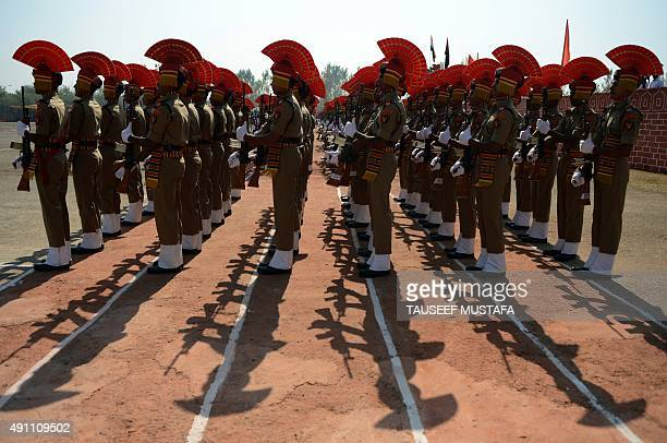 Indian Border Security Force recruits take part in a passing out parade in Humhama on the outskirts of Srinagar on October 3 2015 Some 338 new...