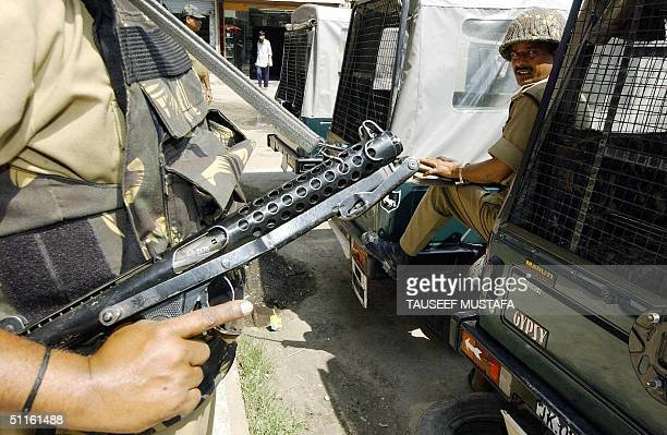 Indian Border Security Force soldier stand guard on a street of Srinagar, 12 August 2004. Security forces have been deployed across the country...