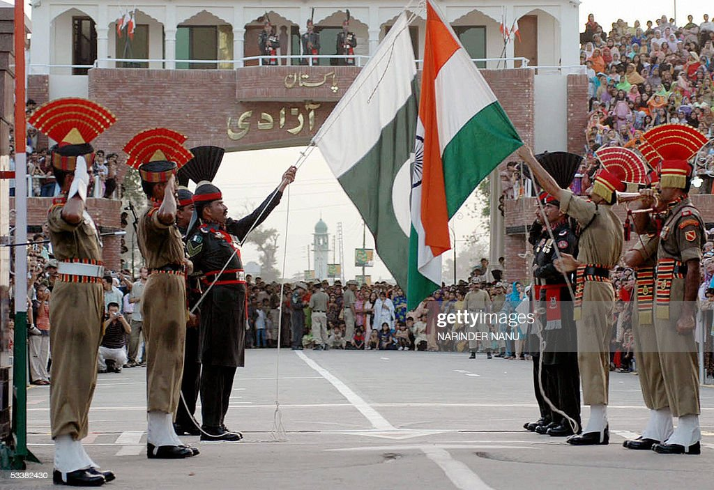 Indian Border Security Force soldiers and their Pakistani counterparts the Rangers perform a flag ceremony at the international IndiaPakistan Wagah...