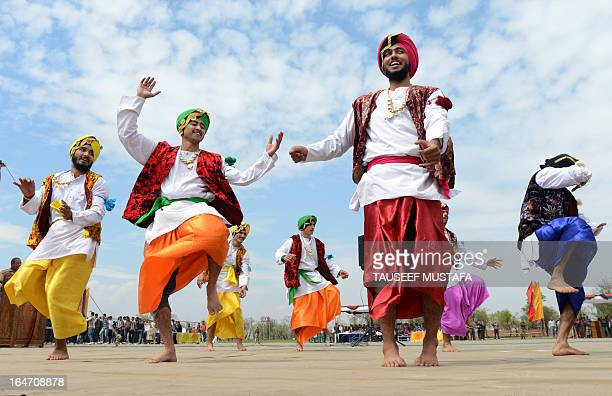 Indian Border Security Force Soldiers dance as they celebrate during the Holi festival inside a camp in Srinagar on March 27 2013 Holi also called...