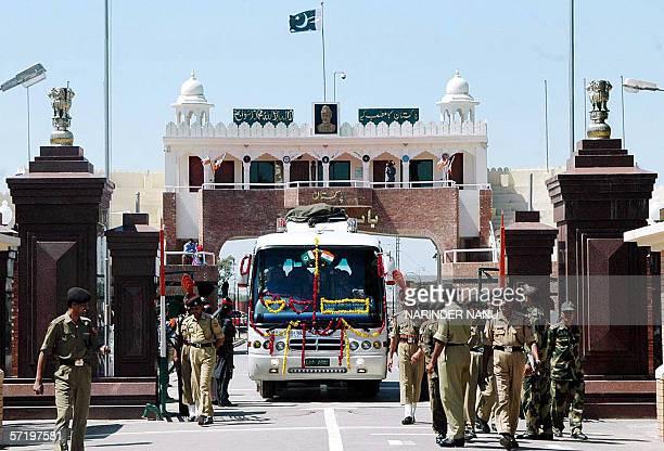Indian Border Security Force soldiers escort the Nankana SahibLahoreAmritsar bus as it crosses the IndiaPakistan border at Wagah 28 March 2006...