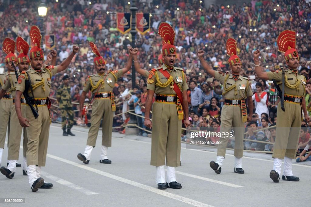 Indian Border Security Force soldiers parade as they take part in the daily beating of the retreat ceremony at the IndiaPakistan Wagah Border Post...