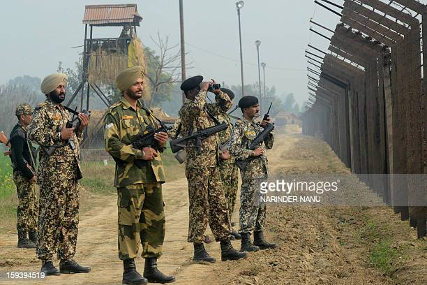 Indian Border Security Force soldiers patrol along the IndiaPakistan border fence about 27 kms from Wagah on January 13 2013 The beheading of an...