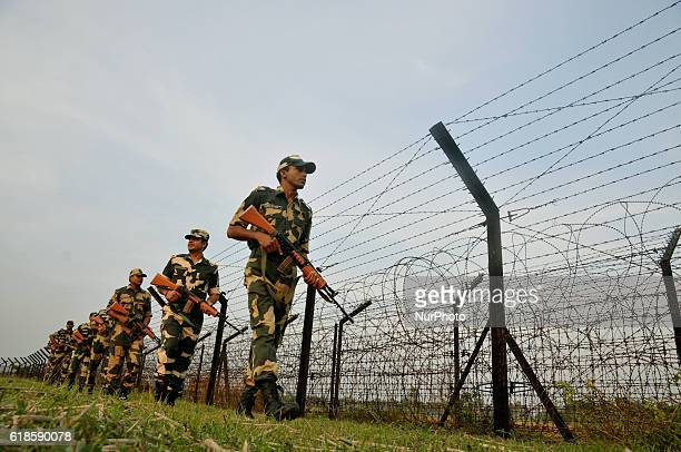 Indian Border Security Force soldiers patrolling at the near Petrapole Border outpost at the IndiaBangladesh Border on the outskirts of...